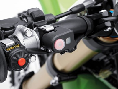 Close up of launch control mode button on motorcycle handlebar